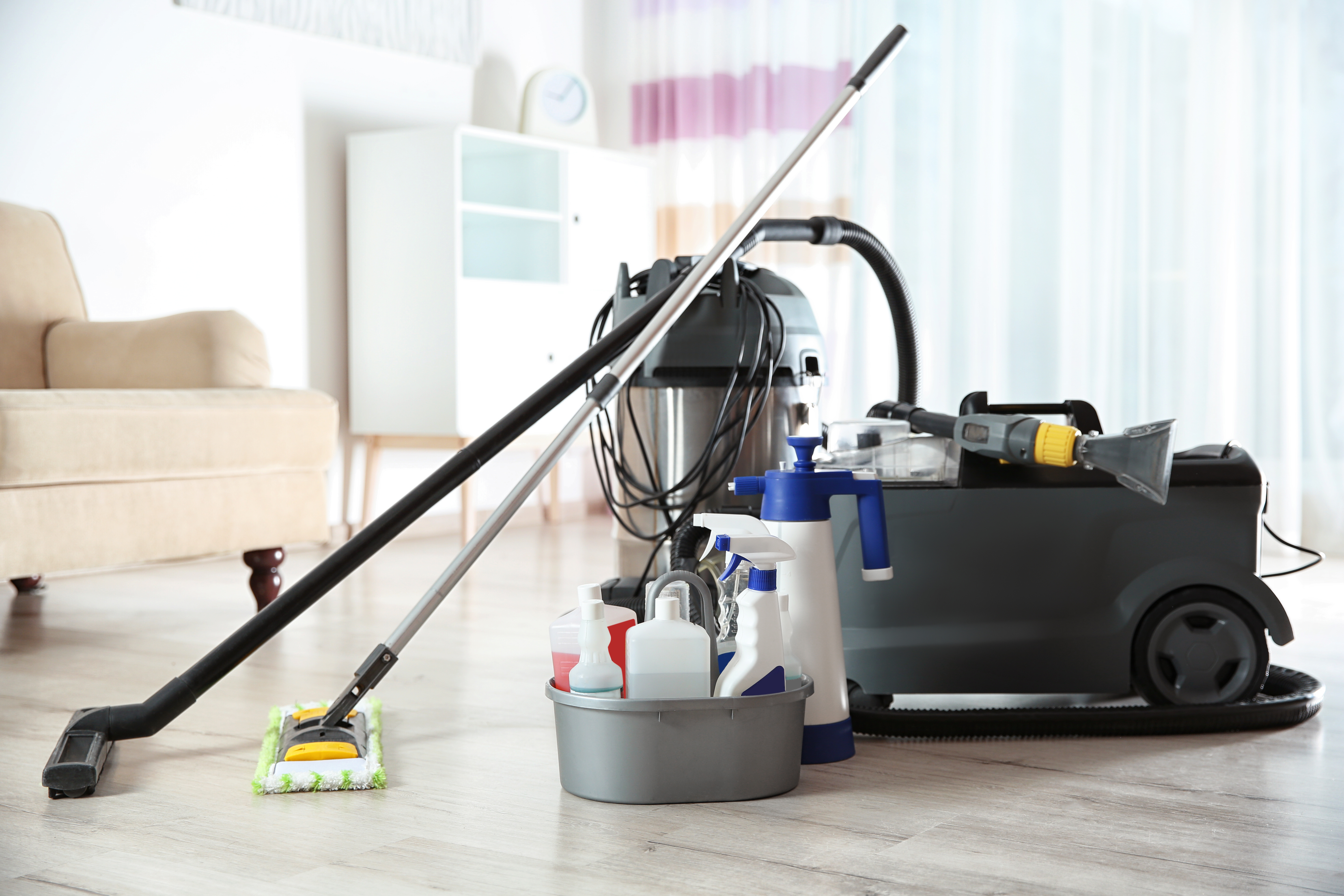 Professional cleaning supplies and equipment on floor indoors